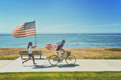 woman running holding an american flag